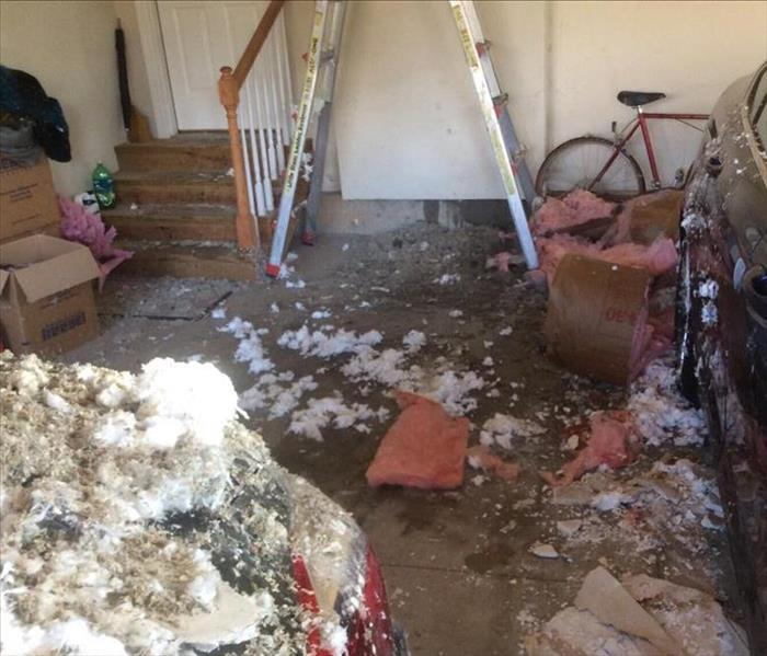 Debris Cleanup in Garage after Busted Water Pipe Before